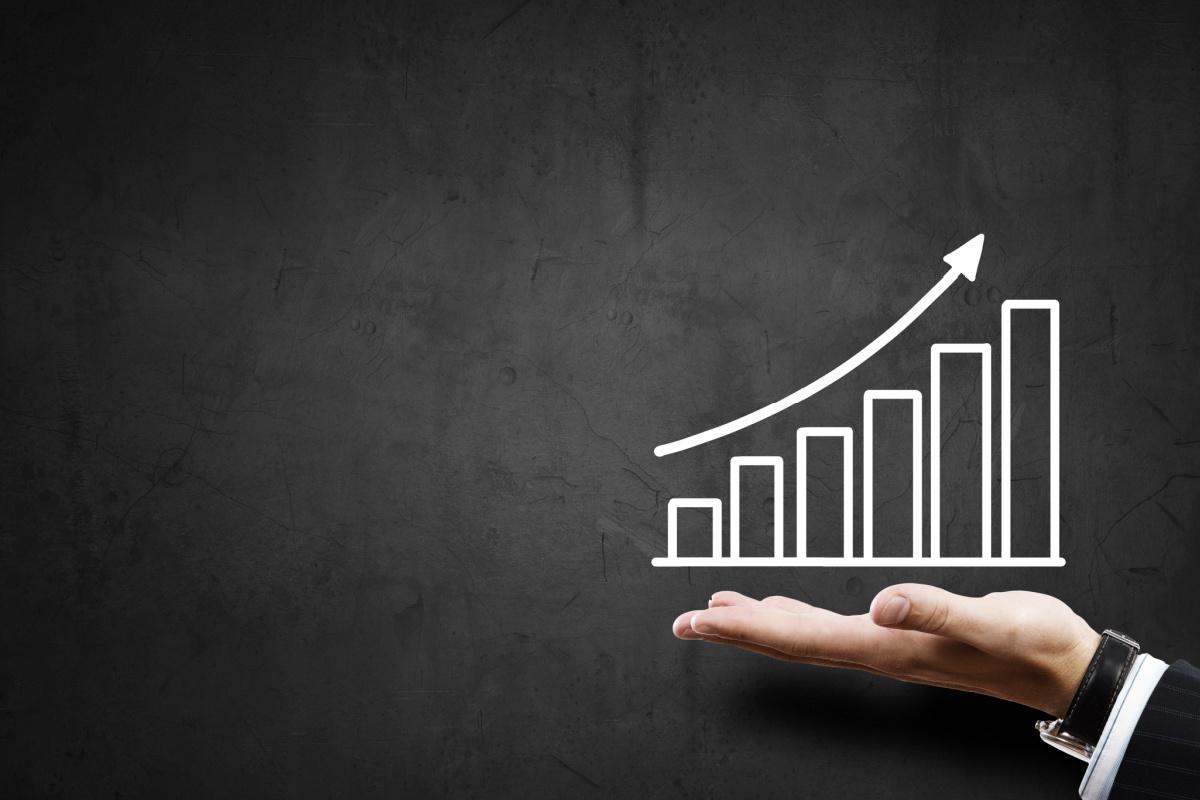 man showing business profit scale